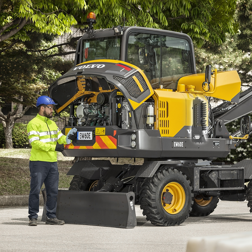 Operator servicing an Volvo EW60E Mini Excavator